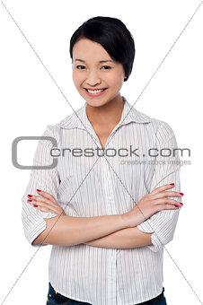 Beautiful young asian girl, arms folded