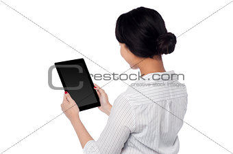 Business woman operating touch pad device