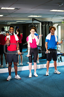 Group of people doing biceps exercise