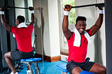 Confident young african guy working out in gym