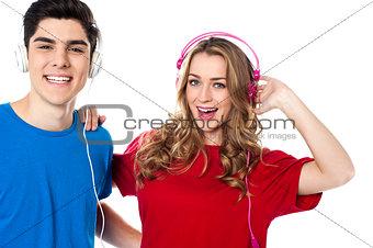 Adorable young couple enjoying music