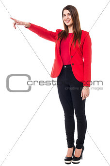 Charming young woman pointing away