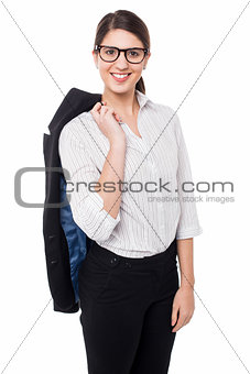 Corporate lady with blazer slung over her shoulder