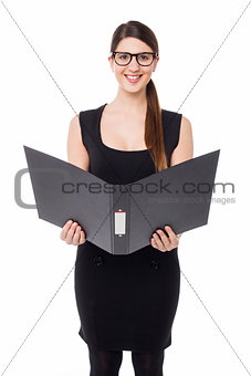 Business lady reviewing file she is holding