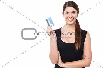 Attractive woman displaying her credit card