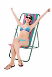 Young bikini woman relaxing on deckchair