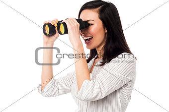 Corporate woman viewing through binoculars