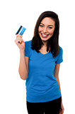 Smiling asian girl showing cash card