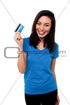 Smiling asian girl showing cash card