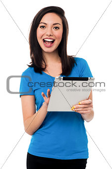 Attractive asian girl browsing on tablet device