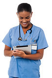 Female physician operating tablet pc