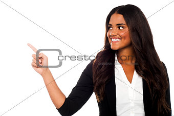 Corporate lady pointing towards copy space area