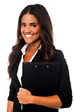 Pretty female secretary holding business files