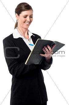 Corporate woman marking her schedule