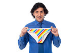 Young man holding multicolored underwear
