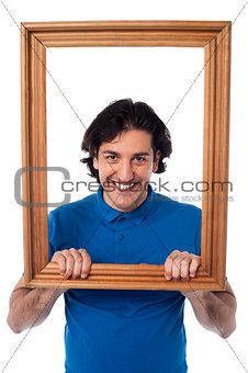 Framed interest, smiling young male