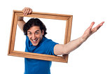 Excited man holding picture frame