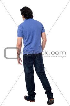 Casual young guy walking in studio