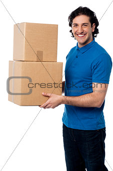 Smart young man carrying boxes