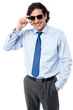 Handsome businessman adjusting sunglasses