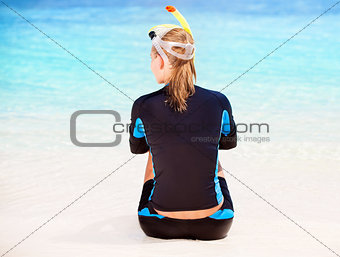 Calm diver girl on seashore