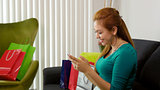 Latina Girl With Shopping Bags Typing On Mobile Phone