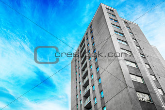 Grey tower block in the city