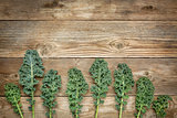 green kale leaves on wood