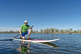 senior male on stand up paddleboard
