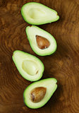 ripe organic avocado cut in half on a wooden background