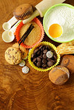 ingredients for baking and desserts cookies, muffins, waffles on a wooden table