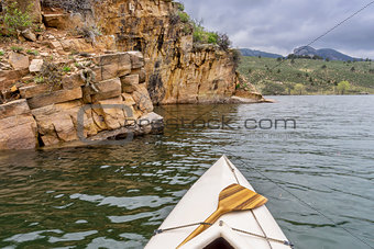 canoe and sandstone cliff