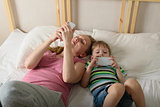 Mother and son playing with phones