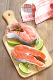 Raw red salmon steaks