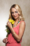 blond cute summer girl with flowers