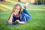 Smiling Young Woman Using Computer Tablet Outdoors