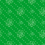 seamless wallpaper. green polka dot background with a flowers