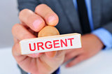 man with a rubber stamp with the word urgent