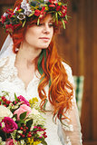 Beautiful red hair bride with flowers