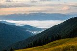 Sunrise foggy mountains