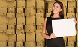 Young businesswoman holding white paper