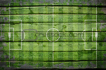 Football stadium with gates painted on wood plank