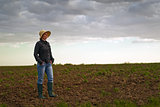 Female Farmer Standing on Fertile Agricultural Farm Land Soil