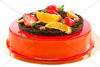Cake with strawberries and orange slices.