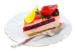Piece of cake with a fresh strawberry and orange.