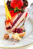 Plate of cake with fresh strawberries and orange.