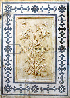 Ancient carved flower on marble in Amber Fort, Jaipur, Rajasthan