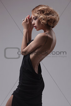 beautiful woman model posing in elegant dress