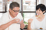 Asian Senior Couple Eating