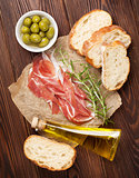 Bruschetta ingredients - prosciutto, olives and olive oil